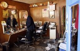 Aaron Biber's vandalized barbershop in Tottenham