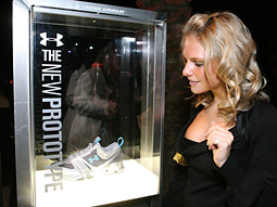 Under Armour displays its new line of cross-trainers at the Maxim Super Bowl party.
