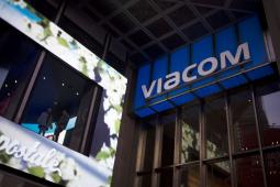 Employees stand in a window next to Viacom Inc.