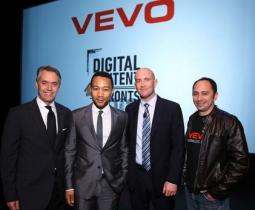 At Vevo's NYC Newfront event last year, (l) Vevo EVP David Kohl, singer John Legend, Vevo President Rio Caraeff and SVP Michael Cerda.