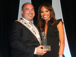 Manny Vidal, President-CEO of The Vidal Partnership, briefly donned Miss USA pageant winner Crystle Stewart's sash in the spirit of the fun evening.