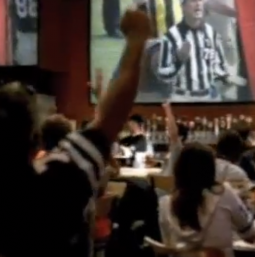Buffalo Wild Wings customers celebrate a bad call in the 'Overtime' spot.
