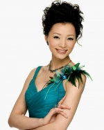 Dong Qing, hostess of CCTV's 2009 Chinese New Year gala, was playfully auctioned off for dinner.