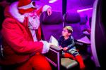 Santa Flies In to Visit Passengers on Virgin Atlantic Plane
