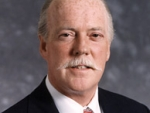 James R. Guthrie is stepping down in July.