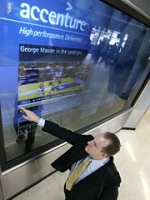 Accenture has set up video screens in airports that allow travelers to manipulate and scrol through content with their hands.