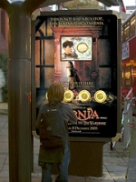 An interactive bus shelter from JC Decaux lets passersby choose which version of a movie trailer they want to watch.
