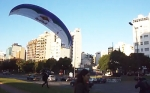 Business Suit-Clad Paraglider Buzzes Around Buenos Aires to Prove 'Red Bull Gives You Wings'