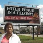 Clear Channel Outdoor said it will take down billboards warning against voter fraud.