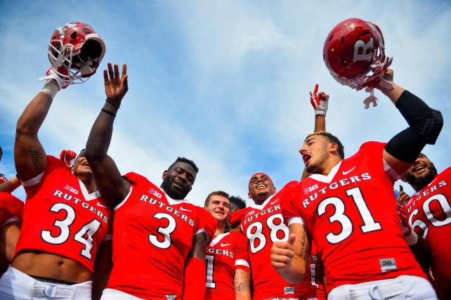 Members of the Rutgers Scarlet Knights celebrate after defeating the Kansas Jayhawks at High Point Solutions Stadium on September 26, 2015 in Piscataway, New Jersey.