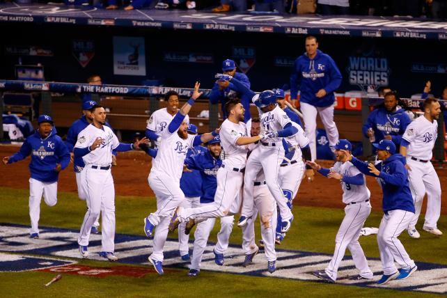The Kansas City Royals celebrate defeating the New York Mets in game one of the World Series on Wednesday morning.
