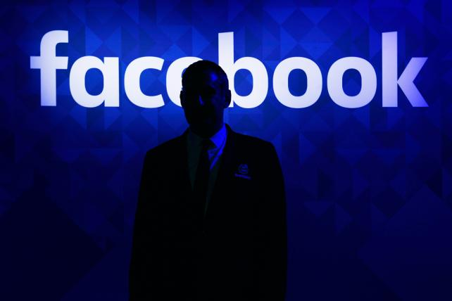 A security guard stands at the entrance to the Facebook lounge at the Web Summit in Dublin earlier this month.