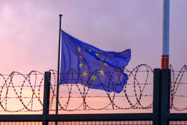 The EU flag flies behind the barricades at Berlin's Tegel airport.