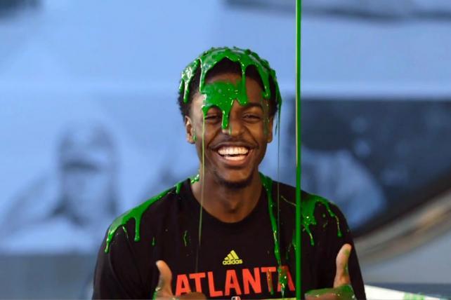 The Atlanta Hawks' Justin Holiday gets slimed.