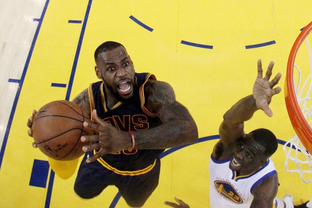 Cleveland's LeBron James soars over Golden State's Draymond Green during Game 5 of the 2015 NBA Finals. Thirty-second spots in this month's Finals rematch are going for north of $500,000 a pop.