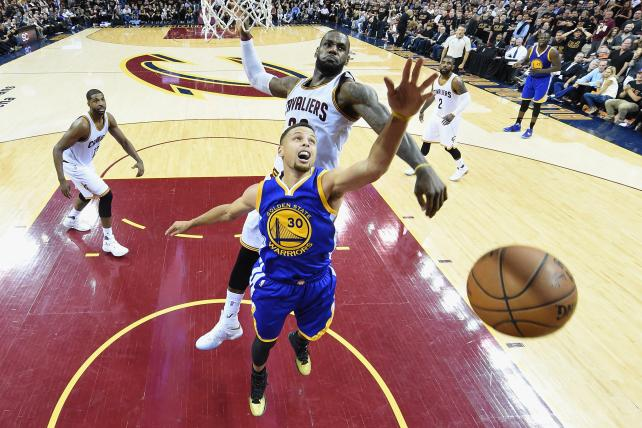 The Warriors' Stephen Curry (#30) has his shot blocked by the Cavs' LeBron James (#23) during 2016 NBA Finals Game 6.