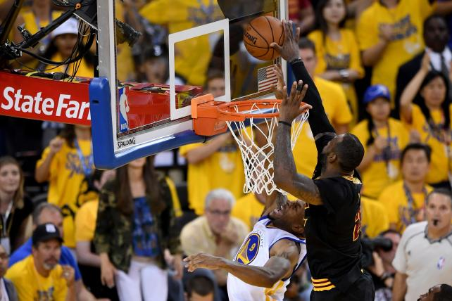 LeBron James of the Cleveland Cavaliers blocks a shot by Andre Iguodala of the Golden State Warriors in Game 7 of the 2016 NBA Finals.