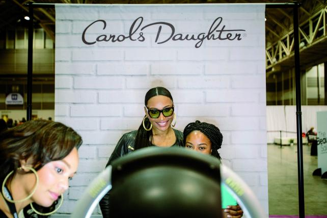 'Real Housewives of Atlanta' star Cynthia Bailey greets fans at the Carol's Daughter booth in the Ernest N. Morial Convention Center.