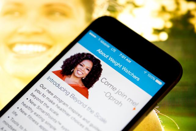 The Weight Watchers International Inc. mobile application is displayed on an Apple Inc. iPhone 6s in an arranged photograph taken in New York, U.S., on Wednesday, Feb. 24, 2016.