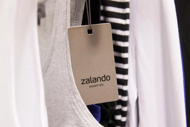 A label hangs from an item of women's clothing in the