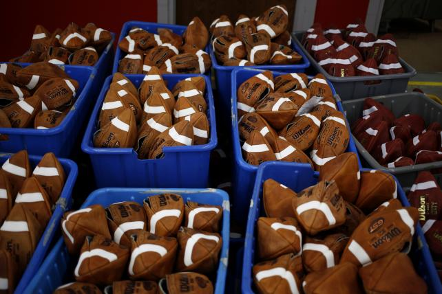 Bins of footballs before being laced up at a Wilson Sporting Goods Co. factory.