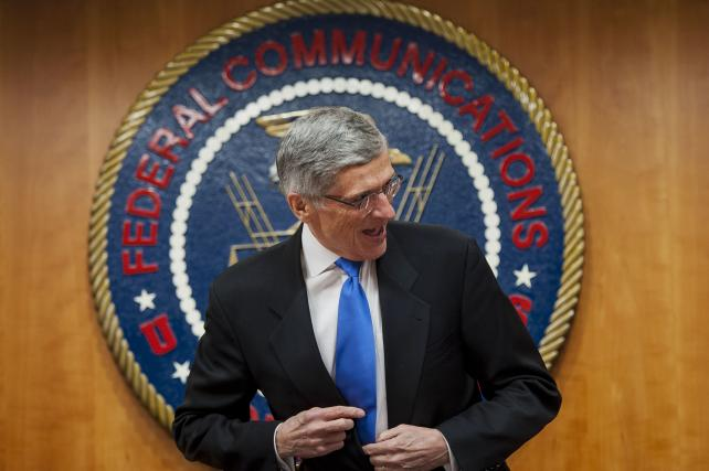 FCC Chairman Tom Wheeler arrives for a meeting to vote on internet regulations in February 2015.