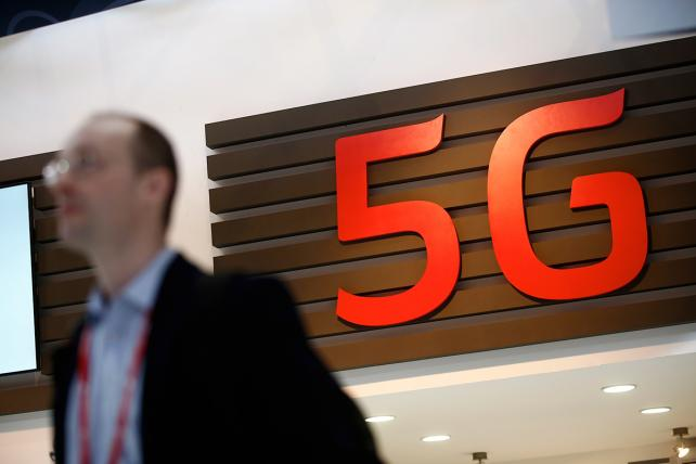 A 5G sign sits on display in a hallway at the 2015 Mobile World Congress in Barcelona.