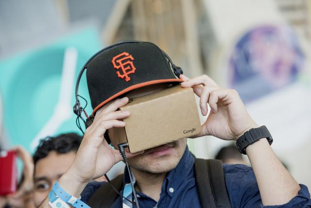 An attendee looks through a Google Cardboard VR viewer during the Google I/O Annual Developers Conference in San Francisco in May.