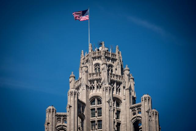 An American flag flies atop the Tribune Tower in Chicago.