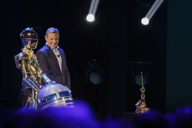 Bob Iger, CEO of The Walt Disney Co., next to 'Star Wars' characters C-3PO and R2-D2 at the D23 Expo in August.