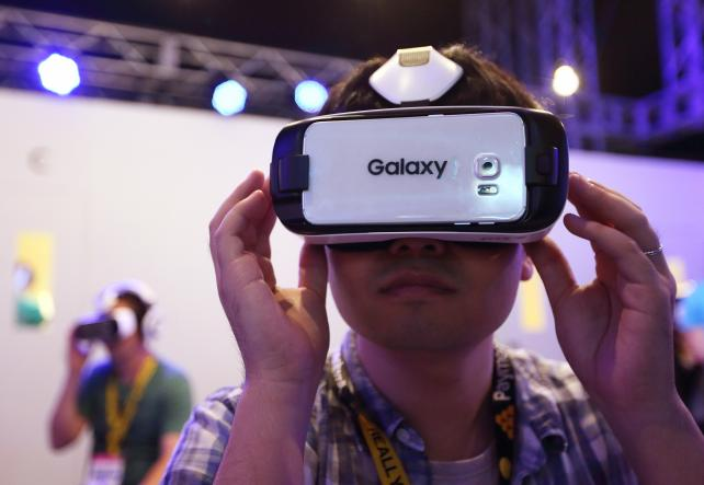 An attendee tries a video game on a Samsung Electronics Galaxy Gear Virtual-Reality headset at the Tokyo Game Show last month.