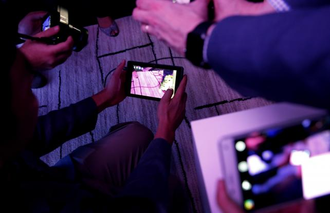 Members of the media view the Project Tango Development Kit during a Google and Lenovo Group event at the Consumer Electronics Show in Las Vegas on Thursday.