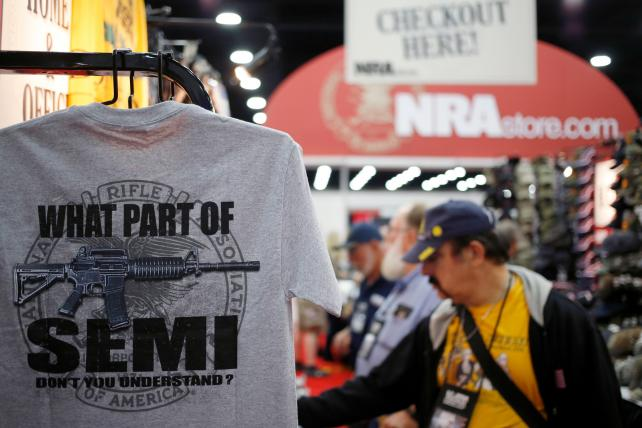 Shirts are displayed for sale on the exhibit floor during the National Rifle Association (NRA) annual meeting in Louisville, Kentucky, U.S., on Friday, May 20, 2016.