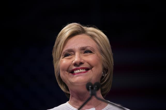 Hillary Clinton smiles during a primary night event June 7 in Brooklyn.