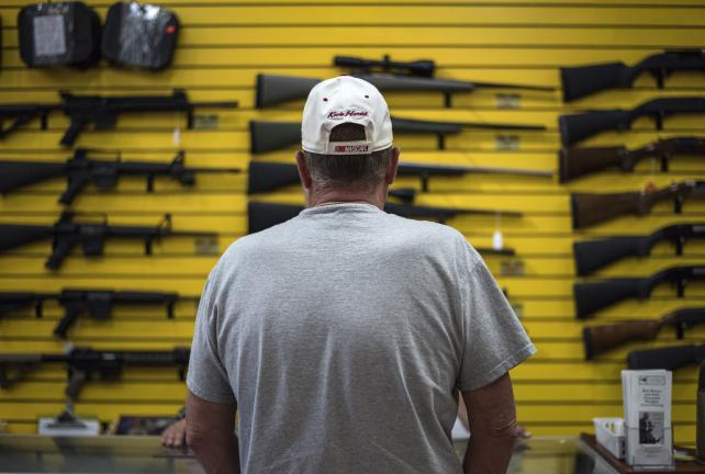 A customer speaks with one of the owners at ABQ Guns in Albuquerque, New Mexico, in 2016.