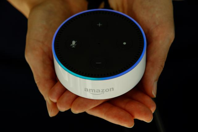 An Amazon Echo Dot, which can be controlled by the Alexa Voice Service.