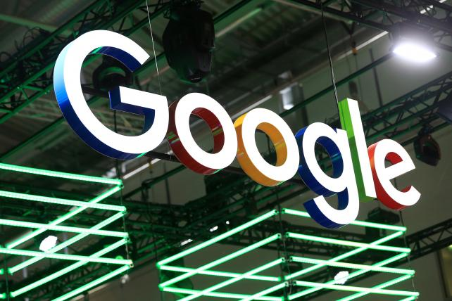 The Google logo hangs over the company's exhibition stand at the Dmexco digital marketing conference in Cologne, Germany, in September.