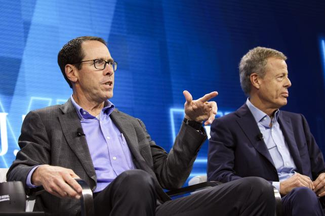 Randall Stephenson, chairman and chief executive officer of AT&T, left, speaks while Jeff Bewkes, chairman and chief executive officer of Time Warner, listens during the WSJDLive Global Technology Conference last Tuesday.