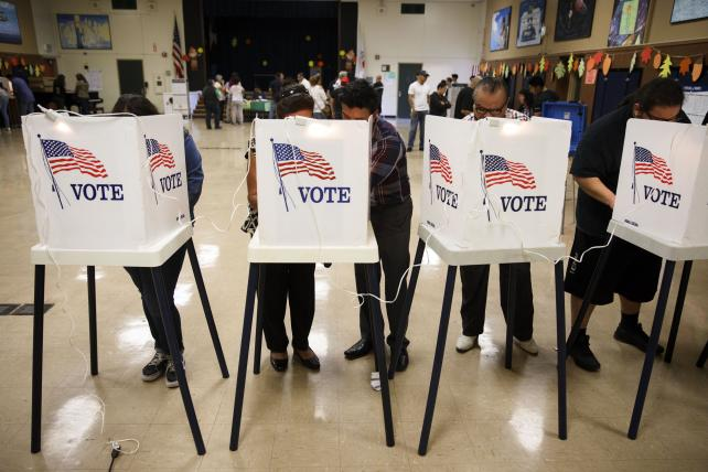 Voters cast ballots at the Brooklyn Avenue Elementary School in Los Angeles on Nov. 8.