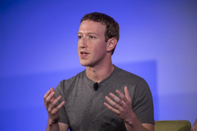 Facebook CEO Mark Zuckerberg seen during a session at the Techonomy 2016 conference in Half Moon Bay, Calif., on Thursday, has said that 'more than 99 percent' of what people see on Facebook is authentic.