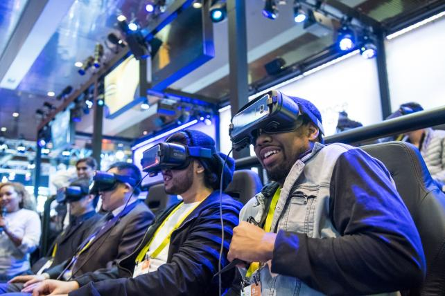 Attendees ride the Samsung Galaxy Gear virtual reality 4D Experience during the 2017 Consumer Electronics Show in Las Vegas, on Jan. 6, 2017.
