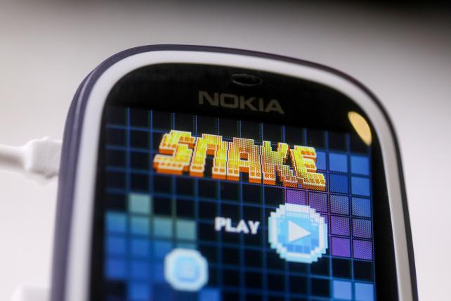The 'Snake' games sits on the screen of a Nokia 3310 mobile phone, now being re-released.
