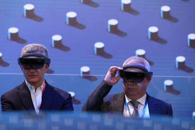 Attendees try smart glasses fitted with a heads up display at the Intel Corp. stand on the opening day of the Mobile World Congress in Barcelona in February.
