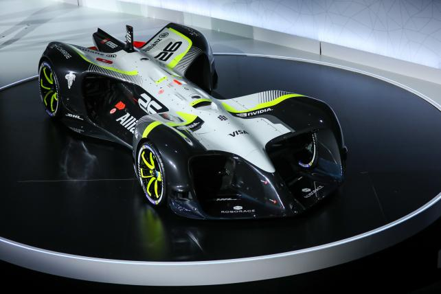 A 'Robocar,' an autonomous racing car, developed by Roborace, sits on the stage after being unveiled on the opening day of the Mobile World Congress.