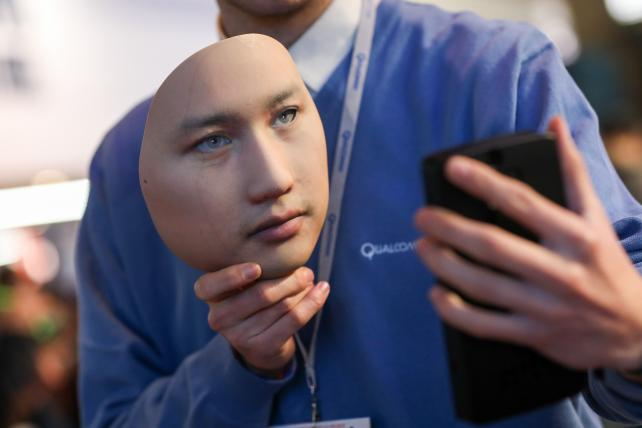 A worker demonstrates the Qualcomm Iris Authentication Solution on the third day of Mobile World Congress MWC in Barcelona last Wednesday.