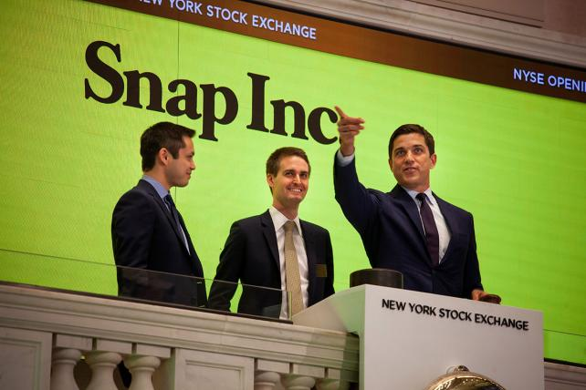 Snapchat co-founders Bobby Murphy and Evan Spiegel, center, opened the New York Stock Exchange on Thursday.