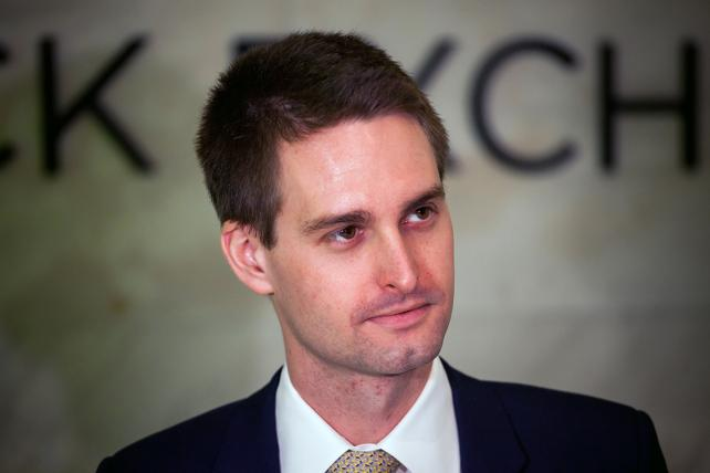 Evan Spiegel, co-founder and CEO of Snap Inc., stands on the floor of the New York Stock Exchange during the company's initial public offering on March 2.