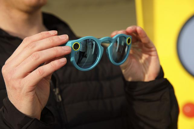 An employee holds Snapchat Spectacles by Snap Inc. at the company's pop-up store in the Venice neighborhood of Los Angeles, California, U.S., on Tuesday, March 14, 2017.