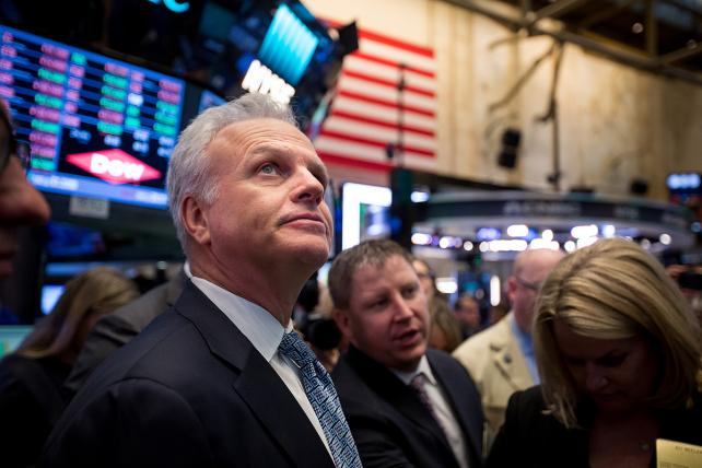 David Neeleman, founder and chief executive officer of Azul SA, left, stands on the floor of the New York Stock Exchange (NYSE) during his company's initial public offering (IPO) in New York, U.S., on Tuesday, April 11, 2017.