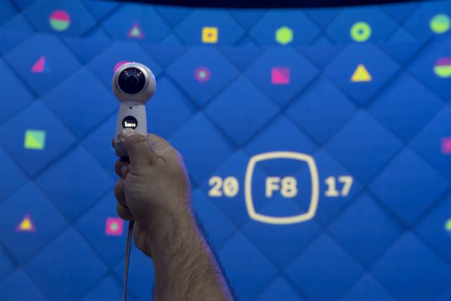 An attendee uses a Samsung Gear 360 camera before the beginning of a keynote address during the F8 Facebook Developer Conference in San Jose, Calif., on Tuesday.
